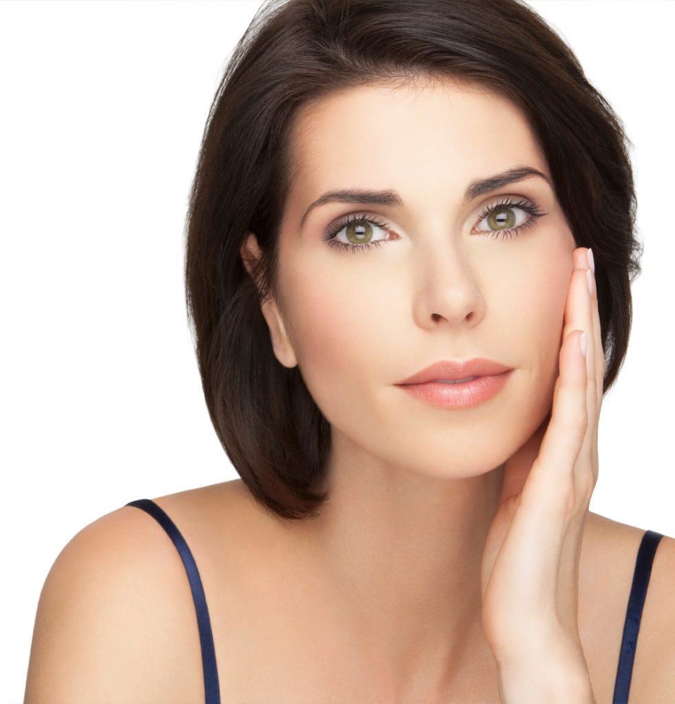 Woman with smooth skin feeling face